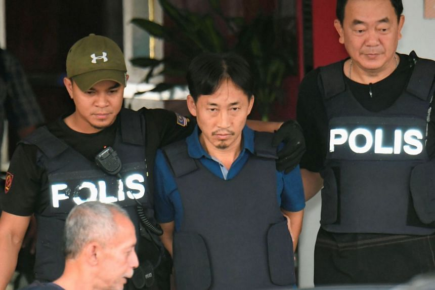 The Malaysian residence of North Korean citizen Ri Jong Chol (centre) was raided after police suspected the premises were used as a clandestine lab to produce nerve agent VX - the poison that killed Kim Jong Nam.