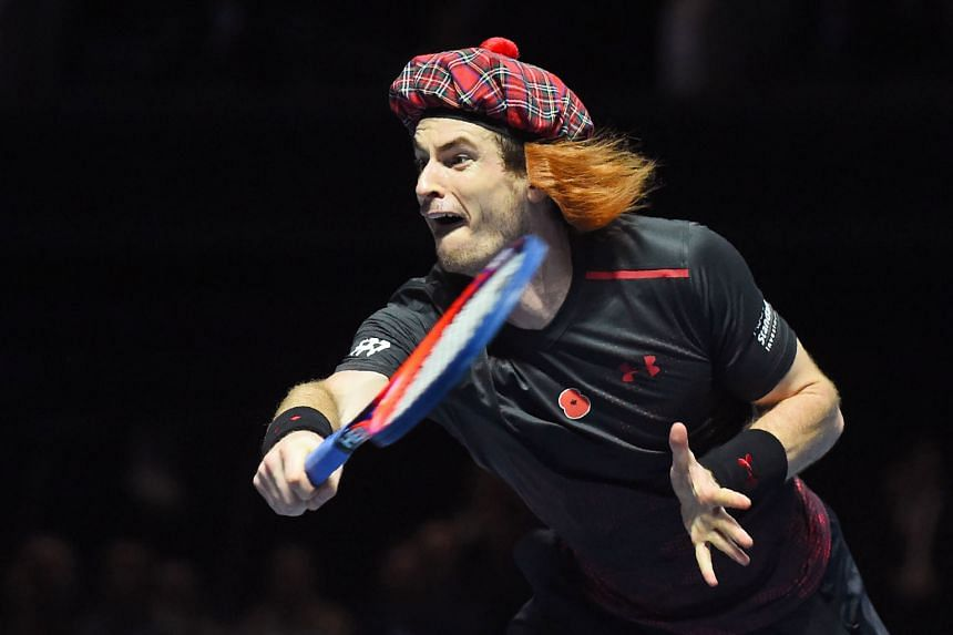 Above: Andy Murray wears a Scottish tam o'shanter tartan hat with fake ginger hair during an exhibition match against Roger Federer in Glasgow on Tuesday. Federer won 6-3, 3-6, 10-6.