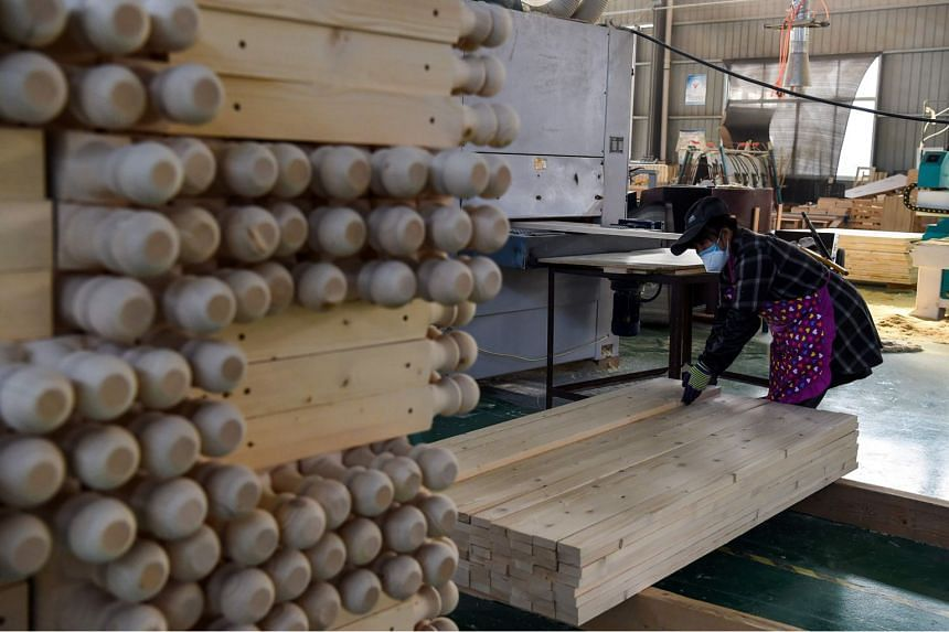 """A worker inside a furniture factory in a """"Taobao Village"""" in Xuzhou, rushing to prepare for the wave of orders about to break on manufacturing businesses across China on the so-called """"Double 11"""" or """"Singles Day"""" on Nov 11."""
