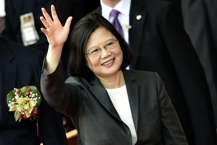 """Taiwan's President Tsai Ing-wen waves while taking part in the National Day ceremony in Taipei on October 10, 2017. Tsai pledged on October 9 to bolster the island's military but added it will not """"seek war"""" amid tensions with its biggest rival China"""