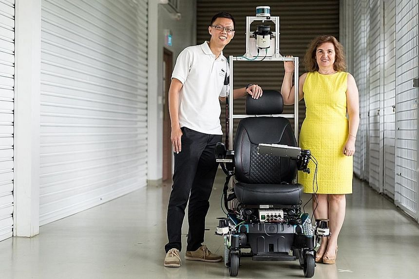 Dr Eng You Hong and Professor Daniela Rus from the Smart Future Urban Mobility team with the self-driving wheelchair that can manoeuvre through tight spaces autonomously. The Technical University of Munich Create is working with the Civil Aviation Au