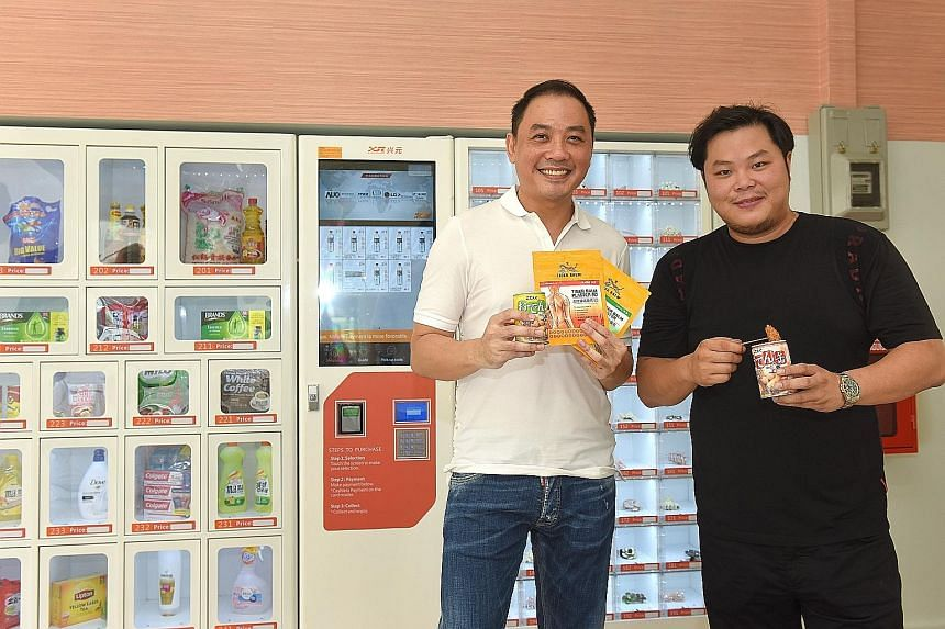 No Signboard's chairman Sam Lim (left) and his business partner Lam Zhi Loong set up The Ma2 Shop, which has six outlets of vending machines selling items such as snacks, ready-to-eat meals and medical supplies. No Signboard will use IPO proceeds to