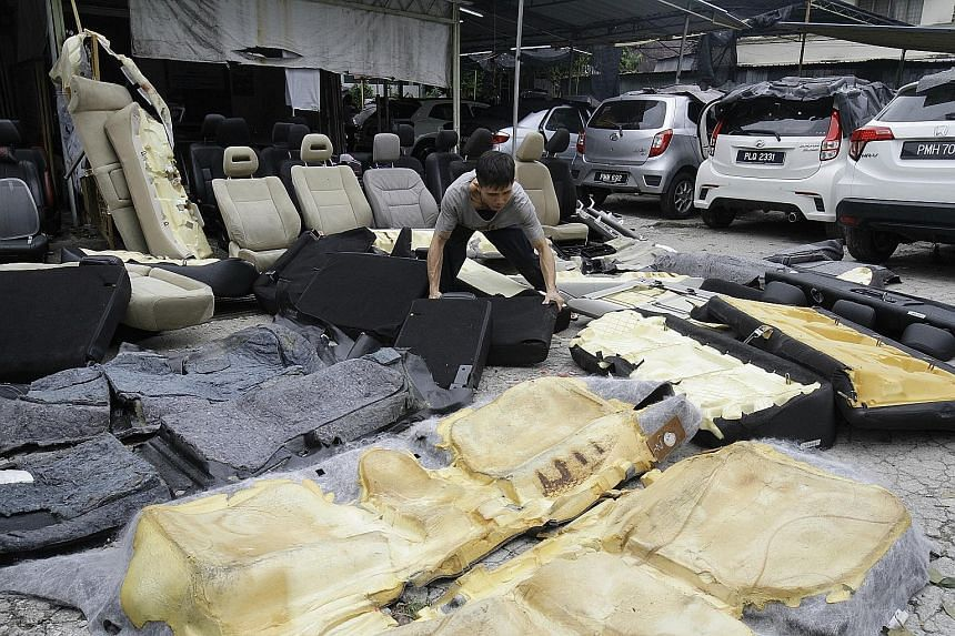 All over Penang, car wash operators and motor workshops are being kept busy washing and fixing vehicles caught in the islandwide floods last weekend.