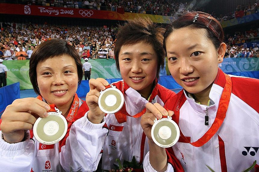 From left: Wang Yuegu, Feng Tianwei and Li Jiawei with their silver medals after losing 0-3 to China in the final of the Beijing Olympics in 2008. After a 48-year wait, Singapore was back on the podium.