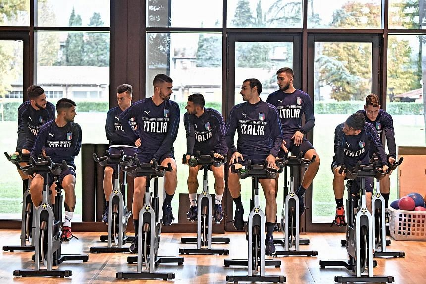 The Italian football team go through their paces in the gym at their training base in Florence. The Azzurri may revert to an old tried-and-trusted system of three at the back to shut out Sweden and seal qualification.