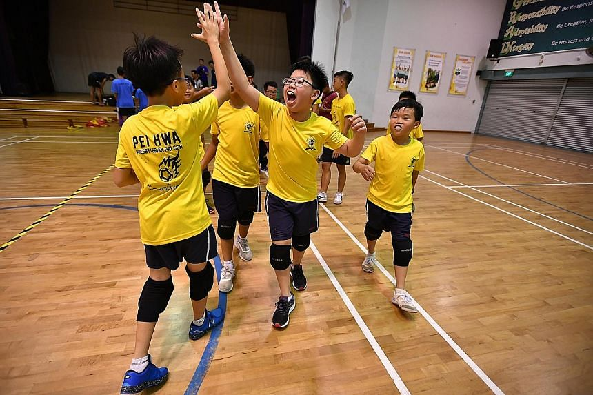 High-fives all round for Ethan Tan (facing camera) and his Pei Hwa Presbyterian Primary team-mates after their triumph in the junior division of the 6th SPH Foundations National Primary Schools Tchoukball Championships. The school beat St Anthony's P