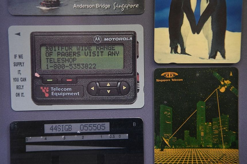 A Citizen Blackie watch (left). Singa the Lion figurines (right). The Super Simon game was considered cutting-edge technology in its time. Phone cards with advertisements and photos on them. A push-button telephone.