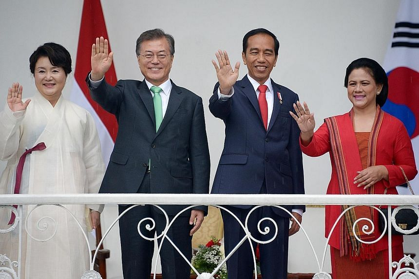 South Korea's President Moon Jae In and his wife Kim Jung Sook with Indonesia's President Joko Widodo and First Lady Iriana Widodo on the veranda of the Bogor palace yesterday.