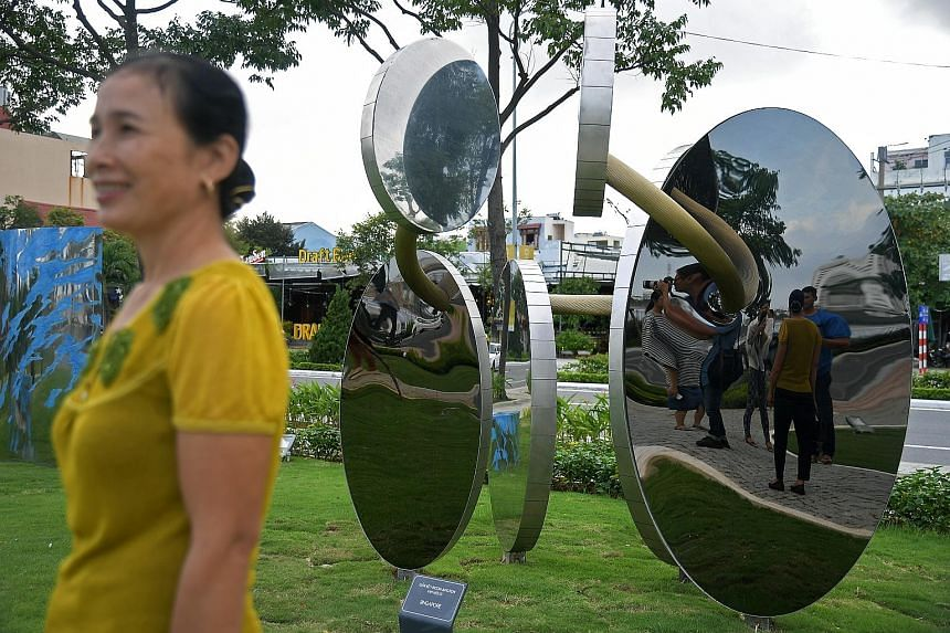 A sculpture by Singaporean artist Tan Wee Lit comprising six shiny metal discs is one of 20 artworks in the new Apec park in Danang, Vietnam. Tan's sculpture, titled Incon-Junction, is made with stainless steel and represents a solitary ring that run