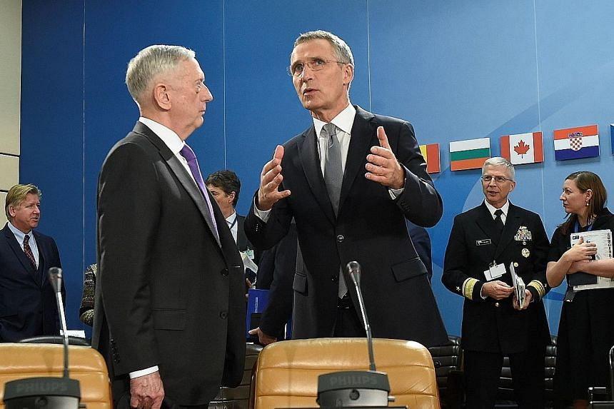 US Defence Minister James Mattis (at left) with Nato chief Jens Stoltenberg at the defence ministers' meeting in Brussels on Wednesday. The changes are part of Nato's biggest shake-up since the Cold War, with defence ministers backing the creation of