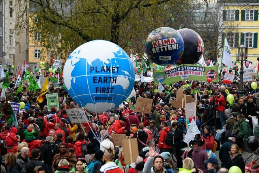 Demonstrators take part in a so-called Climate March against fossil-based energy like coal on Nov 4, 2017 in Bonn, western Germany.