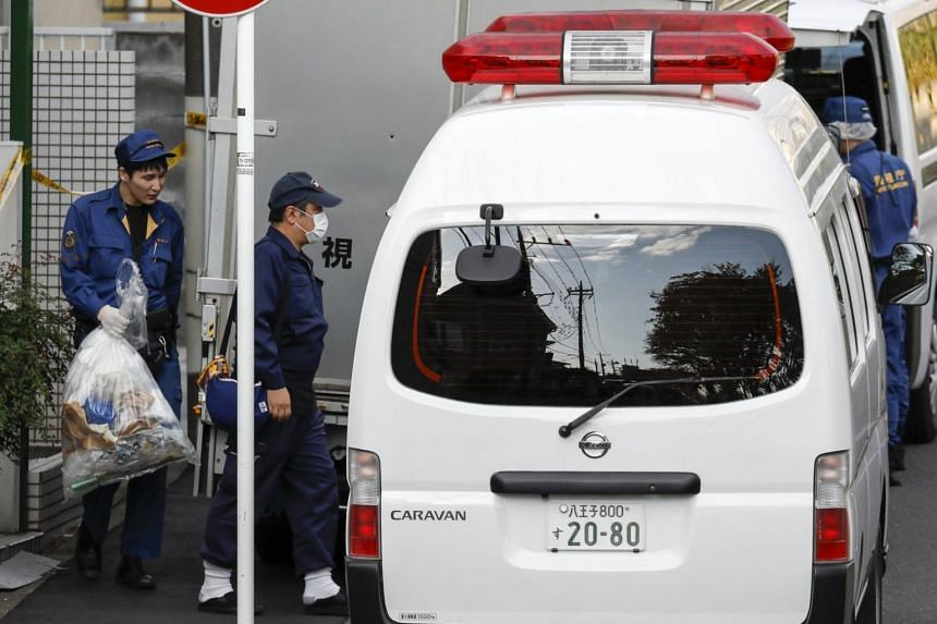 """Investigators removing items from the flat of Takahiro Shiraishi in Zama, Kanagawa Prefecture, Japan, on Oct 31, 2017. He told police he cut up his victims and """"disposed of their flesh and internal organs like trash"""", while keeping their heads and bo"""