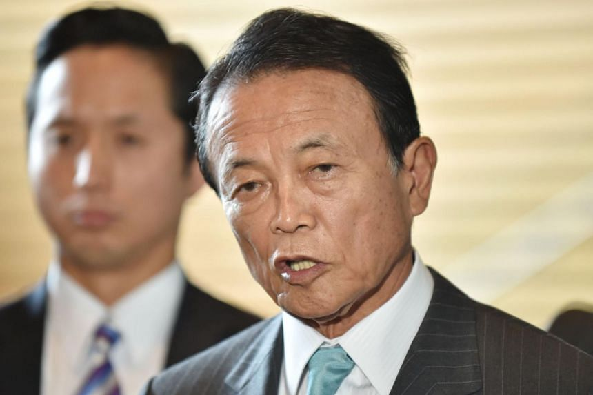 Japanese Deputy Prime Minister and Finance Minister Taro Aso answers questions after a cabinet meeting in Tokyo on Sept 5, 2017.