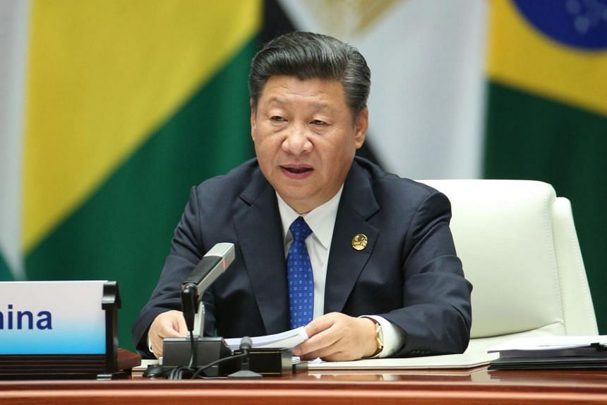 Chinese President Xi Jinping defended multinational trade deals, which he said helped poorer nations benefit from global commerce.
