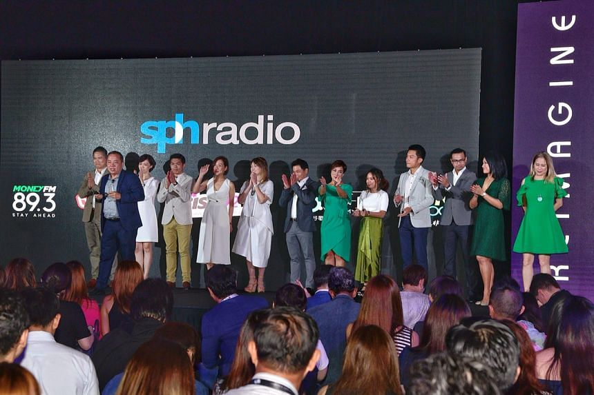 Mr Sim Hong Huat (second from left), General Manager, SPH Radio introducing his new radio DJs from Money 89.3FM and 96.3好FM.