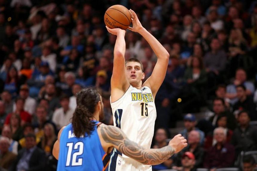 Nikola Jokic of the Denver Nuggets puts up a shot over Steven Adams of the Oklahoma City Thunder at the Pepsi Center on Nov 9, 2017.