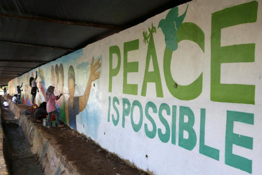Students from Mindanao State University (MSU) paint a mural symbolizing a call for peace after the end of assault against pro-Islamic State militant groups in Marawi on Oct 28, 2017. The main purpose of the meeting is to discuss the situation in Mara