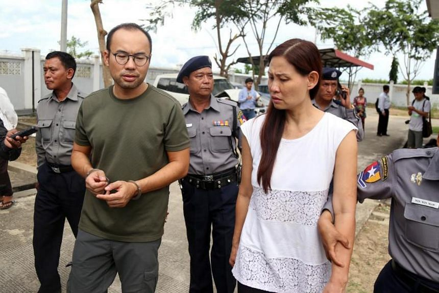 Malaysian journalist Mok Choy Lin (right) and Singapore journalist Lau Hon Meng (left) leave Zabu Thiri court during their first trial in Naypyitaw, Myanmar on Nov 10, 2017.