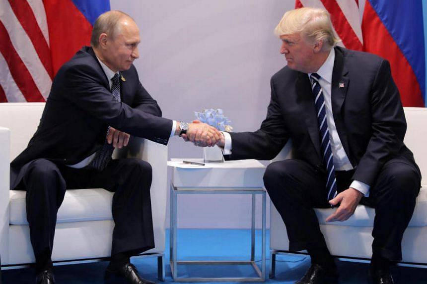 US President Donald Trump shakes hands with Russia's President Vladimir Putin during their bilateral meeting at the G20 summit in Hamburg, Germany on July 7, 2017.