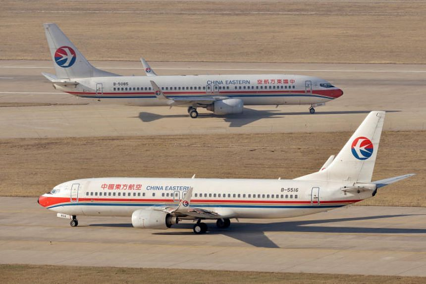 China Eastern Airlines Boeing 737-800 planes are seen at an airport in Taiyuan, Shanxi province, April 6, 2014.