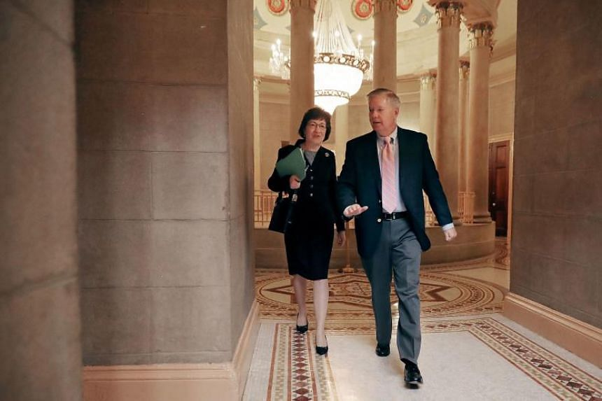 Sen. Susan Collins (left) and Sen. Lindsey Graham (right) arrive for a meeting in the Strom Thurmond Room at the US Capitol on Nov 9, 2017 in Washington, DC.