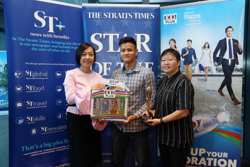F&N Foods General Manager Jennifer See and ST Sports Editor Lee Yulin (right) presents October's ST Star of the Month award to boxer Muhamad Ridhwan.