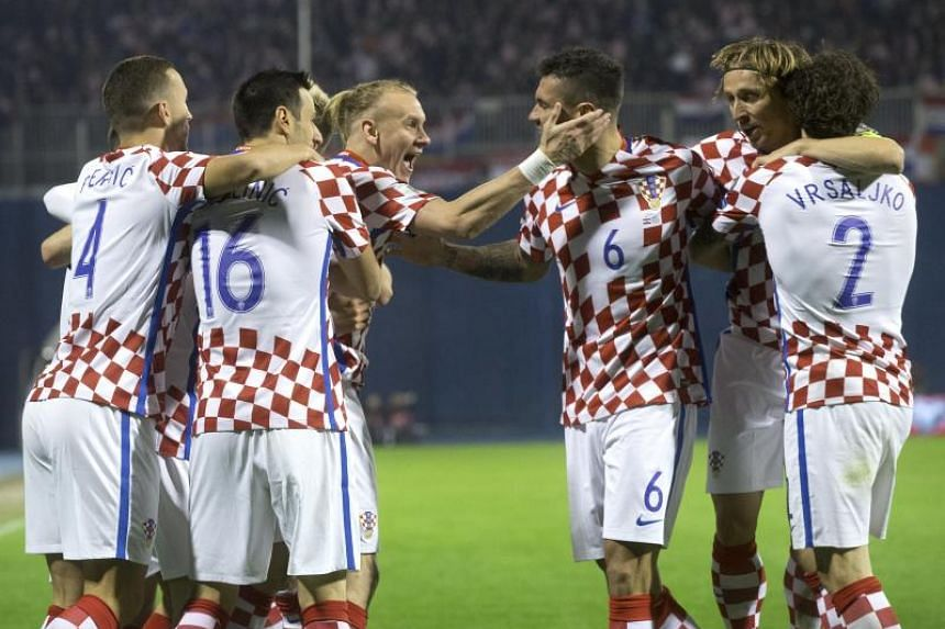 Croatian players celebrate during the 2018 Fifa World Cup play-offs first leg football match between Croatia and Greece.