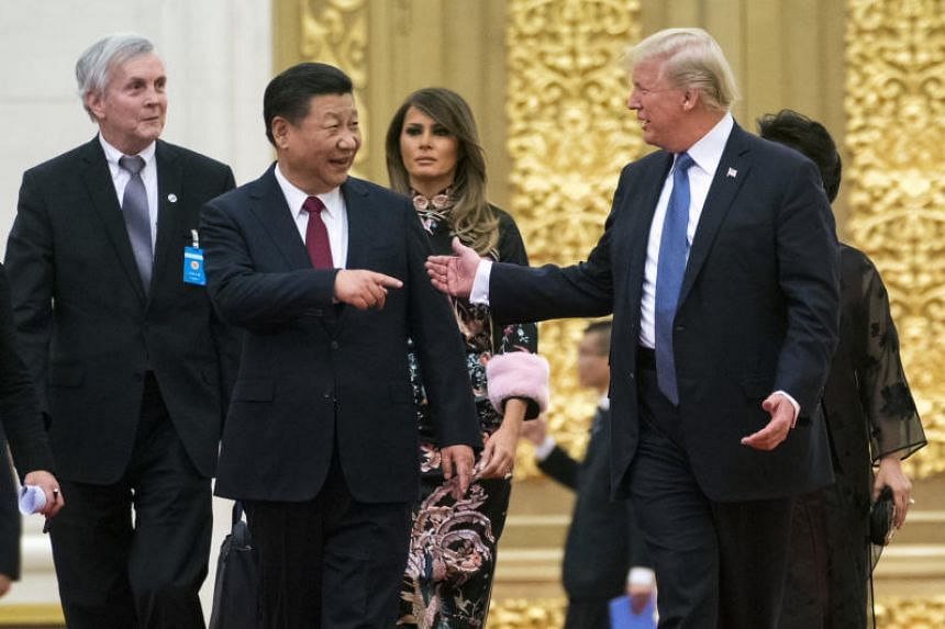 US President Donald Trump and President Xi Jinping of China are trailed by their wives, first lady Melania Trump and Peng Liyuan, as they arrive for a state dinner in Beijing.