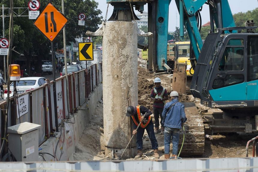 Labourers work on a road construction site in Jakarta on Sept 14, 2017. Indonesian businessmen have made a plea for more private sector involvement in the country's infrastructure development.