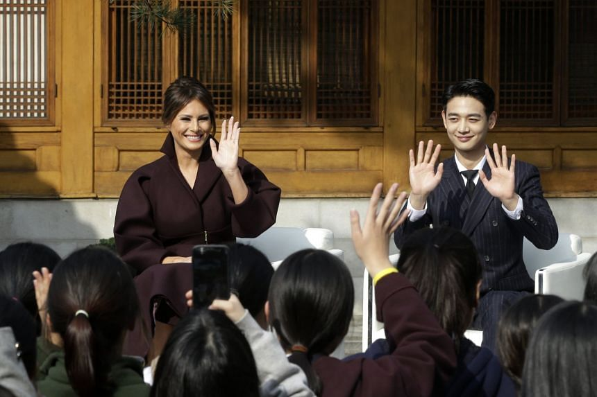 US First Lady Melania Trump and Choi Min Ho, a member of South Korean boy band SHINee, waving to South Korean middle-school students during the Girls Play 2 initiative, at the US Ambassador's Residence in Seoul, South Korea, on Nov 7, 2017.