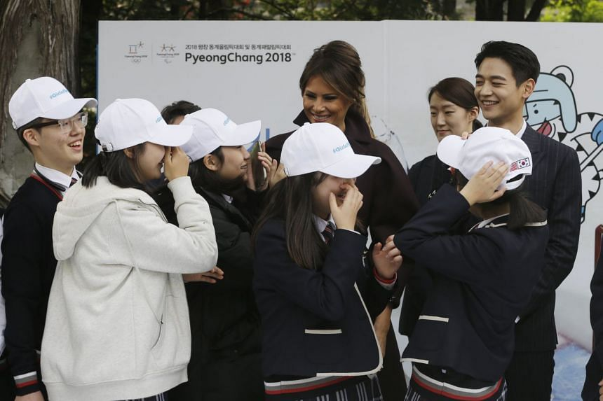 US First Lady Melania Trump being greeted by South Korean middle-school students as Choi Min Ho (top right), a member of South Korean boy band SHINee, looks on during the Girls Play 2 initiative, on Nov 7, 2017.
