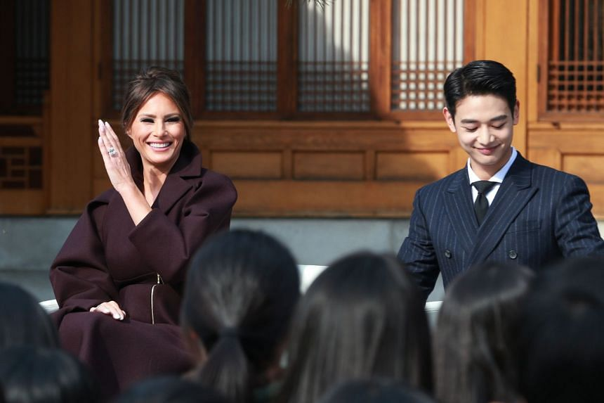 US First Lady Melania Trump (left) smiles as she attends an event while accompanied by Choi Min Ho (right), a member of South Korean boy band SHINee, at the US Ambassador's Residence in Seoul, South Korea, on Nov 7, 2017.