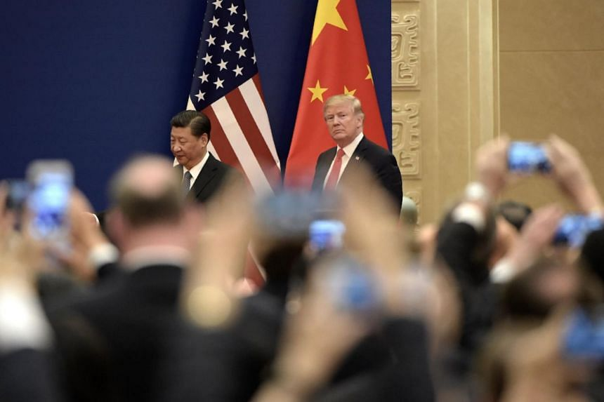 US President Donald Trump and Chinese President Xi Jinping attend a business meeting at the Great Hall of the People in Beijing.