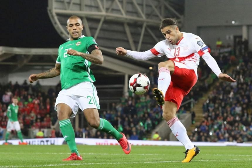 Switzerland's defender Ricardo Rodriguez (right) takes on Northern Ireland's striker Josh Magennis during the Fifa 2018 World Cup qualifier second round football match at Windsor Park in Belfast on Nov 9, 2017.