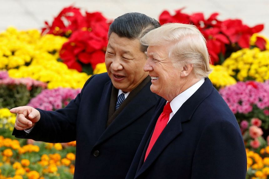 "US President Donald Trump with his Chinese counterpart Xi Jinping at a welcome ceremony in Beijing yesterday. Mr Trump, who is on a three-day state visit to China, said he and Mr Xi discussed ""mutual commitment to the complete denuclearisation of N"