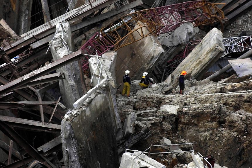 Security consultant Michael Won set up the Scene of Crime Unit - the predecessor of the CID forensics division - in 1975. Forensics officers have since gone on to play a crucial role in cases like the Nicoll Highway collapse (left).