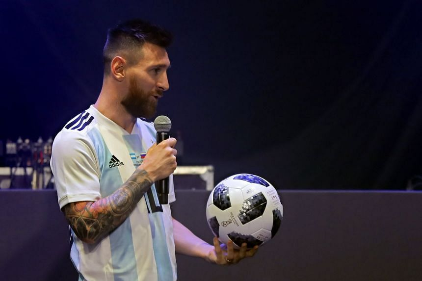 df46b4b24 Argentinian national football team striker Lionel Messi poses with Telstar  18, the official match ball