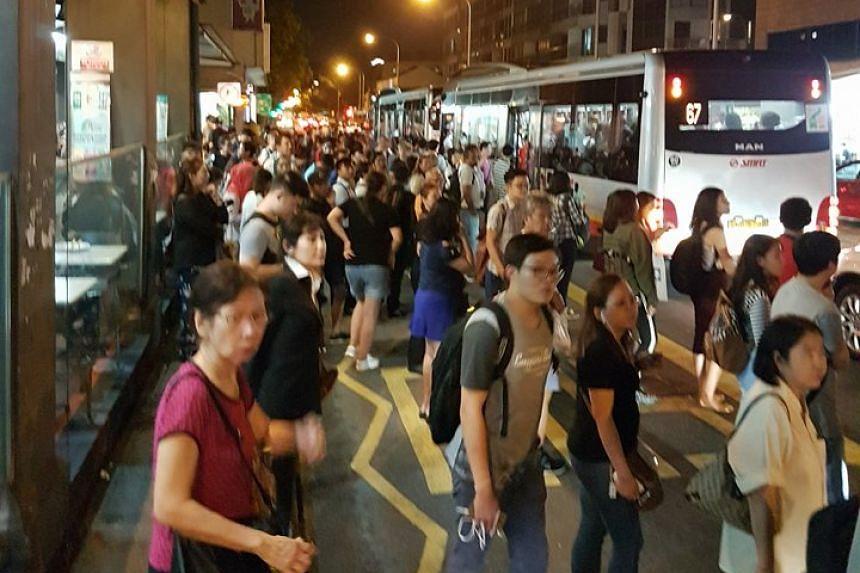 Stranded passengers at the bus stop near Aljunied MRT.