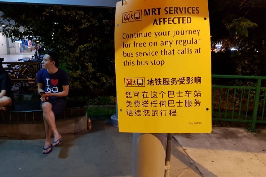 A sign outside Aljunied MRT station informing the public of the delays.