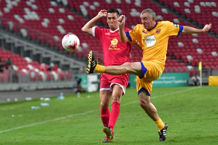 Liverpool's Luis Garcia fights for the ball with Arsenal's Nigel Winterburn.