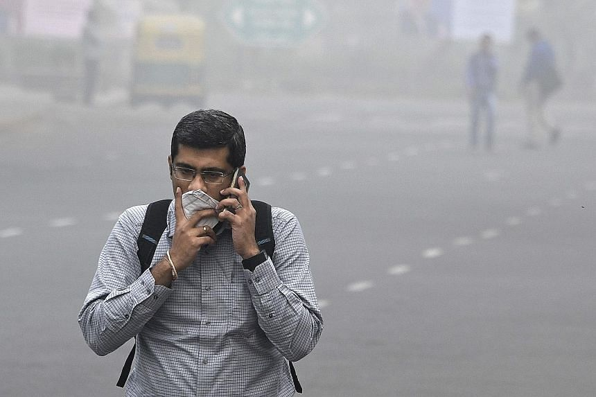 A man protecting himself from the smog in New Delhi on Wednesday.