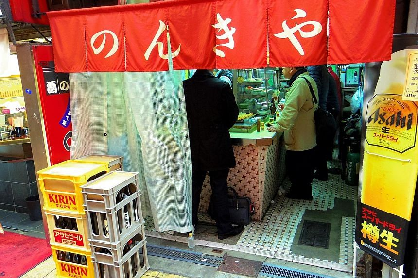 "(Left) A tachigui stall in Tokyo that serves hot oden - a Japanese winter dish similar to yong tau foo. ""Tachigui provides a great option for people who do not have companions to eat with but want to eat out, or have no time to cook,"" says tachigui r"