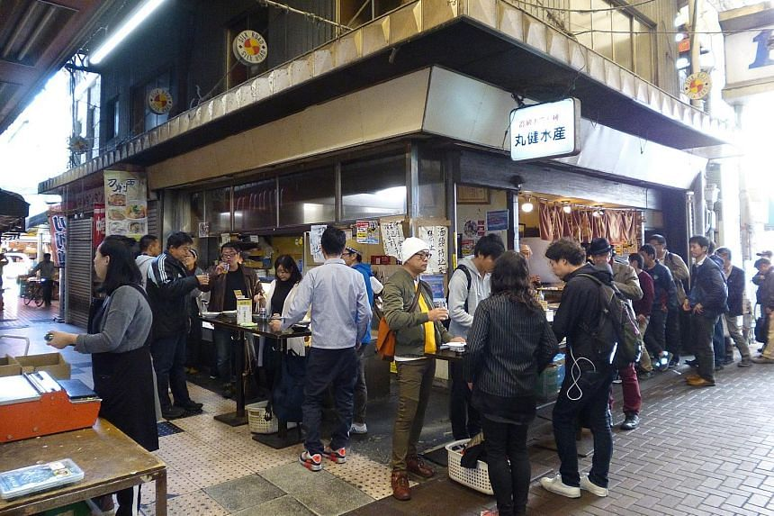 """(Left) A tachigui stall in Tokyo that serves hot oden - a Japanese winter dish similar to yong tau foo. """"Tachigui provides a great option for people who do not have companions to eat with but want to eat out, or have no time to cook,"""" says tachigui r"""