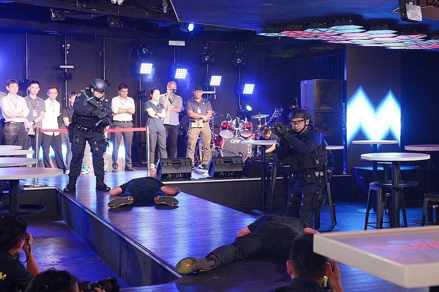 During the counter-terrorism simulation yesterday, gunmen who opened fire in a Clarke Quay nightclub were swiftly taken down by police officers.