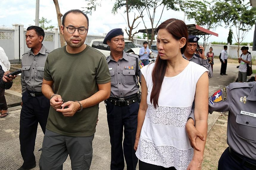 Singaporean journalist Lau Hon Meng (far left) and Malaysian producer Mok Choy Lin leaving the court after their trial yesterday in Naypyitaw. They were working on a documentary for Turkish Radio and Television Corporation when they were held on Oct