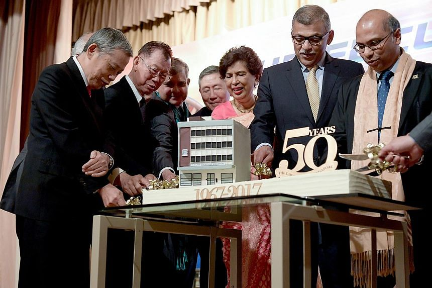 Chief Justice Sundaresh Menon (second from right) and Law Society president Gregory Vijayendran (far right) cutting a cake with past Law Society presidents (from left) Peter Cuthbert Low, Giam Chin Toon, Philip Jeyaretnam, Michael Hwang, and Arfat Se