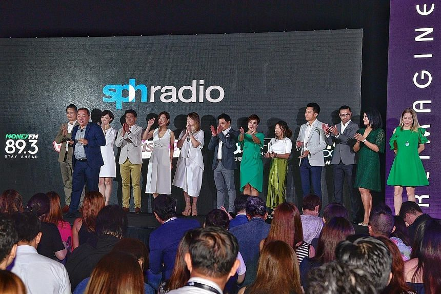 Mr Sim Hong Huat (second from far left), general manager of SPH Radio, introducing the radio DJs who will be on Money FM 89.3 and 96.3 Hao FM. The business and personal finance station is set to launch on Jan 29, while the Mandarin infotainment stati