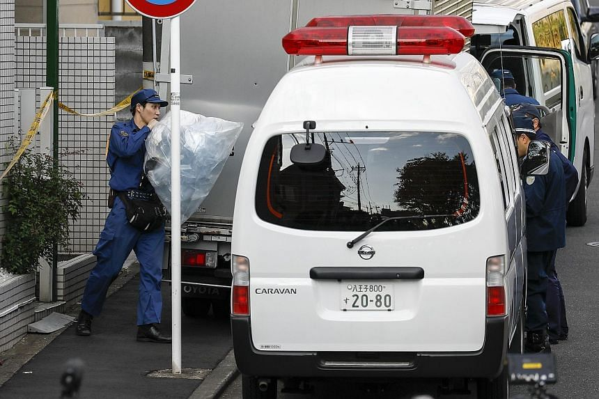 Investigators taking out plastic bags containing evidence from Takahiro Shiraishi's home in Kanagawa prefecture on Oct 31. Nine heads and 240 bones belonging to his victims were found in his apartment.