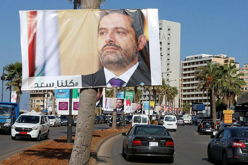 Posters of Mr Saad al-Hariri, who resigned as prime minister last Saturday, in Beirut, Lebanon, yesterday. Lebanon believes he is being detained in Saudi Arabia and its President has demanded his immediate return.