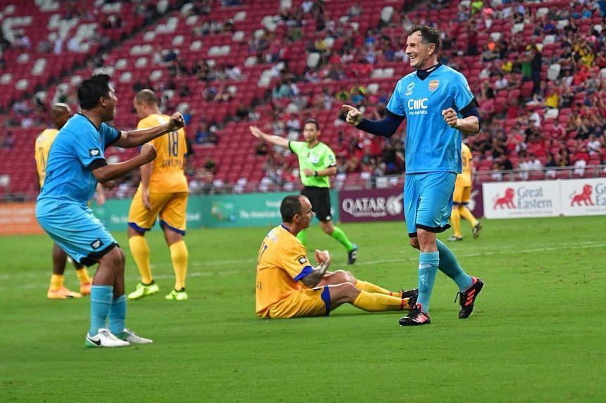 Aleksandar Duric celebrates after scoring against Arsenal.